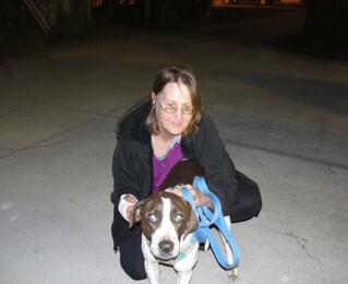 Susan being reunited with Charlie Brown after he stayed at the We Care For Paws facility