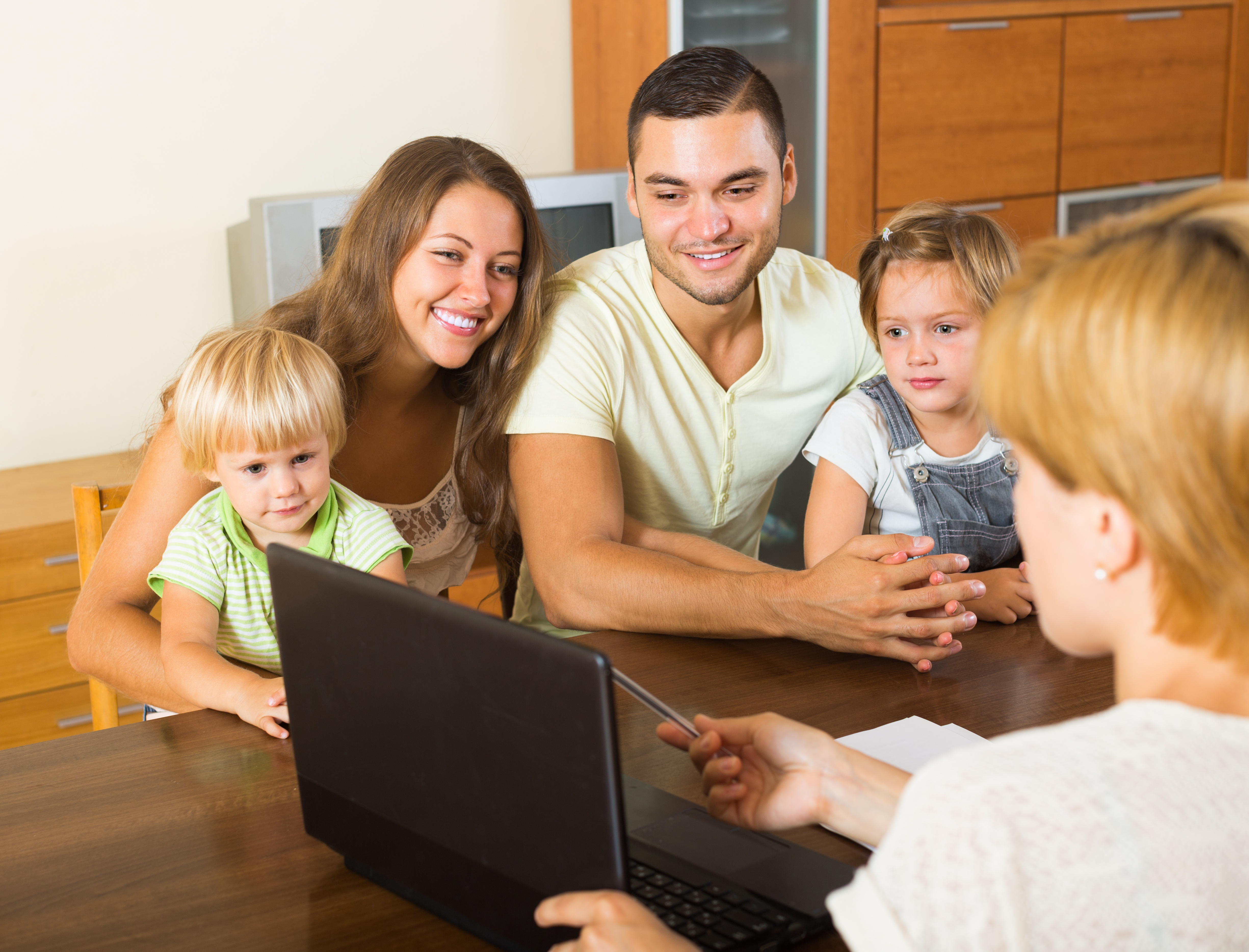 A social worker assisting a family