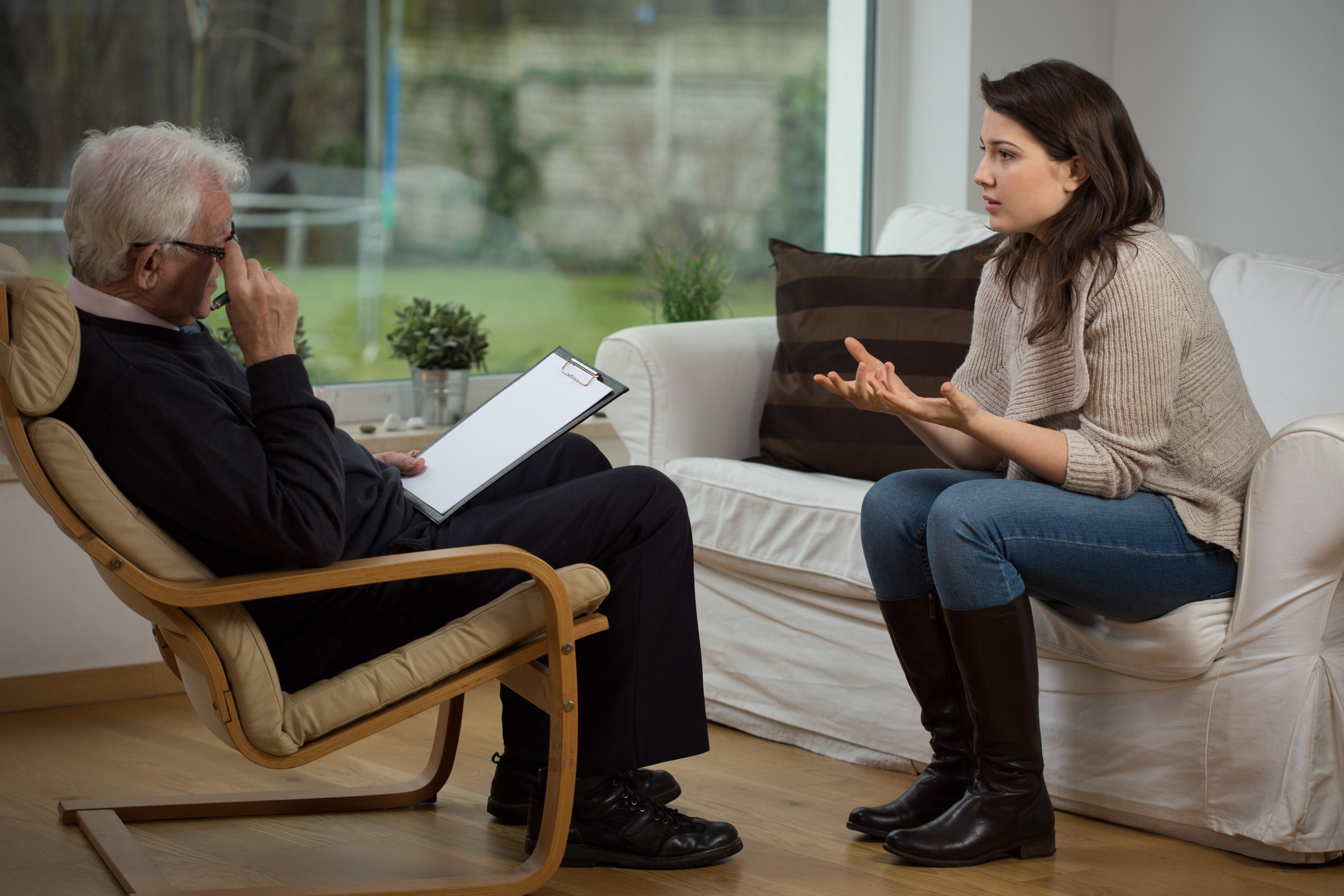 Woman talking to a therapist while sitting on a couch